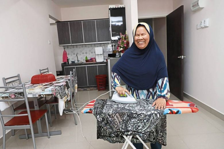 Blind woman Esah bought Penang house in cash